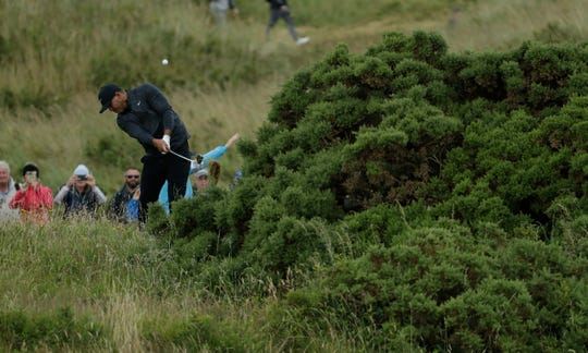 Brooks Koepka of the United States plays a shot to the 17th green during the first round of the British Open Golf Championships at Royal Portrush in Northern Ireland, Thursday, July 18, 2019.