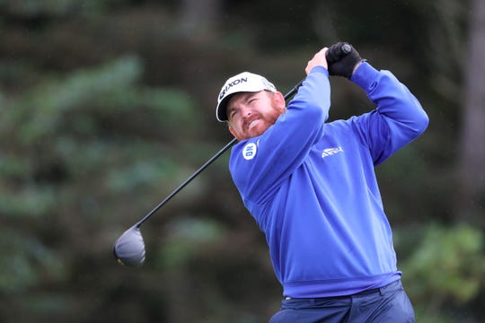 J.B. Holmes of the United States plays tee shot on the 5th hole during the first round of the British Open Golf Championships at Royal Portrush in Northern Ireland, Thursday, July 18, 2019.
