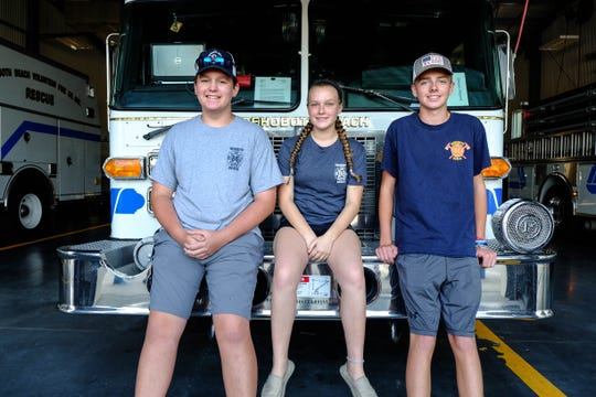 Jeremiah Burton, Zoe Peters and Wyatt Simpler are junior firefighters at Rehoboth Beach Fire Department. Fire departments everywhere are struggling to recruit young people.