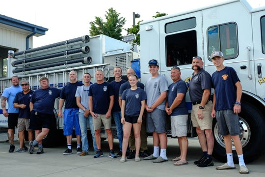 Members of the Rehoboth Beach Fire Department stand outside the station.