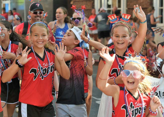 Athletes who will participate in the USSSA softball tournament celebrate during the event's opening ceremony on Wednesday, July 17, 2019.