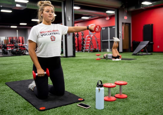 Hailey Langston works out her arms on the turf floor at GreatLife Fitness on South Sertoma Avenue, Wednesday, July 17.