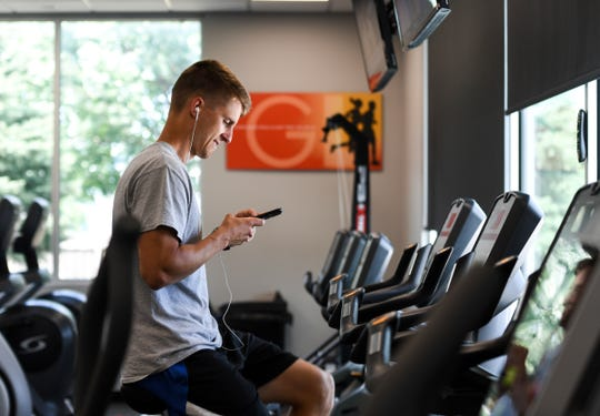 Heath Vanwyhe, a member of GreatLife Fitness, uses the bicycle machine, Wednesday, July 17. GreatLife Fitness has a location on South Sertoma Avenue in Sioux Falls.