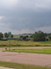 Storm clouds form to the west of Sioux Falls, on Thursday, July 18.