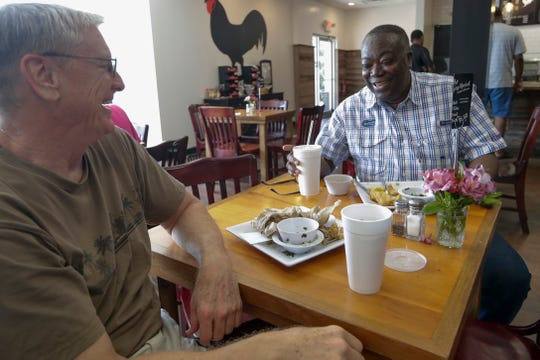 Steve Burgess, a retired attorney, and Seth Ablordeppeuy, a FAMU professor, who have been friends for at least 25 years, meet for lunch at Earley's Kitchen Thursday, July 18, 2019.