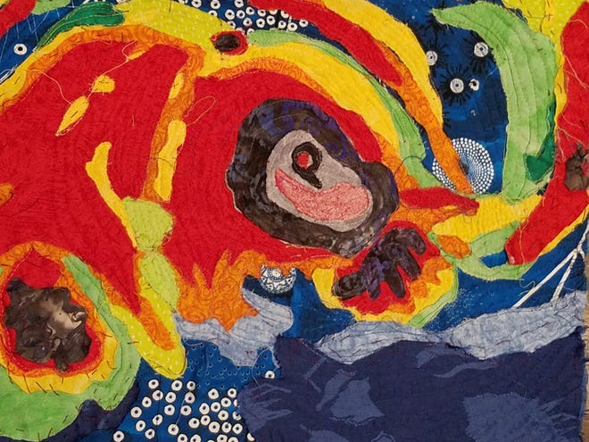 """Leslie Cohen's quilt  weaves the eye of a hurricane out of hot colors, swirling it into a cacophony of texture that speaks to the idea of """"growth."""""""