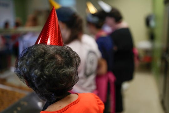 Kearney Center kitchen volunteers served the millionth meal with party hats on over their hair nets Thursday, July 18, 2019.