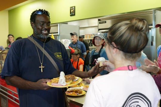 Oscar Gude gets a special treat as the millionth meal is served at the Kearney Center in July. This week's cold weather brings needs for extra items at the center.