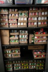 One of the many cabinets of food stored in the FAMU food pantry Thursday, July 18, 2019. The cabinet was stocked with peanut butter and assorted canned goods.