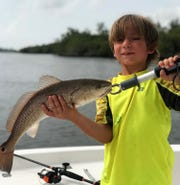 Ryder Burr, 6, of Hobe Sound caught his first redfish last weekend fishing near St. Lucie Inlet.