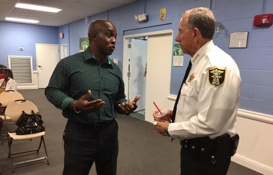 Minister Adam Jolly (left), who grew up in Stuart and now lives in St. Lucie County, talks with Martin County Sheriff William Snyder before the NAACP of Martin County's Community Empowerment Panel at the 10th Street Community Center in Stuart on Thursday, July 18, 2019. Jolly has spoken before about his efforts to improve the community after spending time in prison following crimes in Stuart.