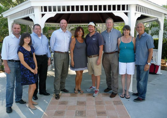 In this April 2015 file image, Leisure Square Pavilion Volunteer Committee Members stand in front of the pavilion they helped to build: Sam Jelmby, Suzi Davis, Robert Paugh, Lincoln Irons, Bev Paris, Jeff Matthews, Robert Slezak, Marsha Damerow and Martin Paris: Not pictured are Tony Donadio, Tony Della Porta, Chris Long, Robin Pelensky, Brad Schuh and Martina Tannery