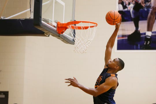UTEP's Bryson Williams goes for a dunk during basketball practice Thursday, July 18, 2019, at the Foster Stevens Basketball Center in El Paso.