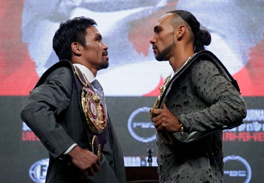 Manny Pacquiao, left, and Keith Thurman pose during a news conference Wednesday, July 17, 2019, in Las Vegas, for their welterweight championship boxing match scheduled for Saturday in Las Vegas.