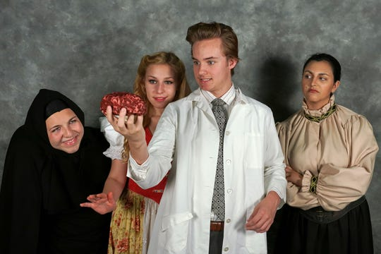 "Young Artists Ensemble presents Mel Brooks' ""Young Frankenstein"" July 26 to Aug. 4 at the Newbury Park High School Performing Arts Center.  Sam Bevill, center, plays Frederick Frankenstein, Adrian Viecco, left, plays Igor, Charlotte Green plays Inga and Margaret LeFleur plays Frau Blücher in the show."