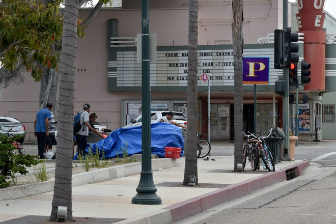 Some transients store their belongings in the corner of a public parking area in Downtown Oxnard.