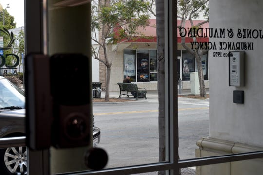 Electronic security locks and surveillance monitors were installed at a Downtown Oxnard insurance office to address security concerns due to transients in the area.