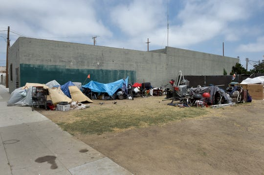 A small transient encampment sits in an empty lot on Meta Street in Downtown Oxnard on Thursday.