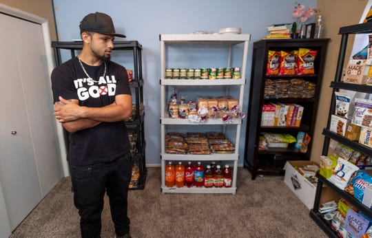 Rapper turned street preacher Ray Yung has started a food pantry in a bedroom of his Visalia home. He gives food to families in need, with no questions asked. All he asks is that they pray with him.