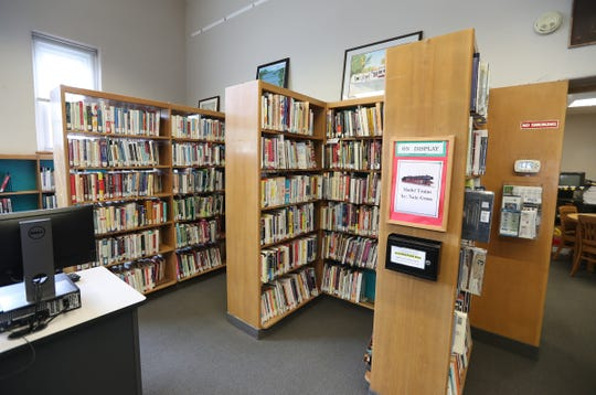 Book stacks and tables at the Rose Memorial Library in Stony Point on Thursday, July 18, 2019.