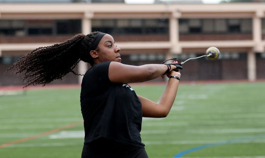 Monae Cooper, a senior at Northeastern University and a former New Rochelle High School hammer thrower, is pictured on the field at the high school in New Rochelle, July 18, 2019.