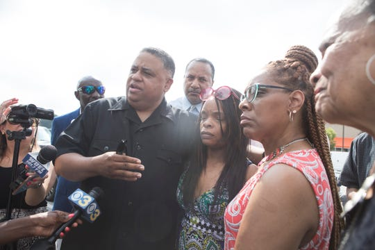 Pastor of Canaan Baptist Church Rev. Christopher Bullock, left, Lyonni Flowers, center, and Lisa Flowers speak with the media about the noose that was found inside the Miller Road Home Depot last week in Wilmington.