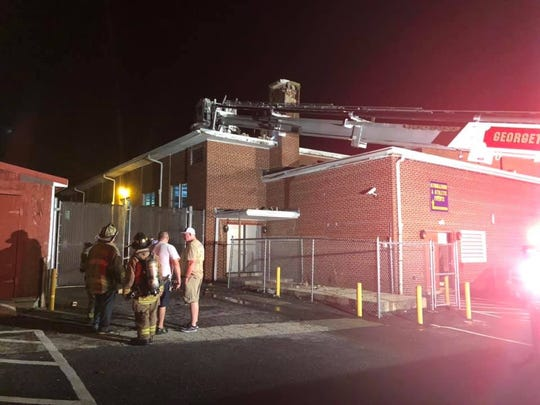 Volunteers of the Georgetown Fire Company at Georgetown Middle School after what fire officials said was a lightning strike on the chimney.