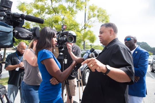 Pastor of Canaan Baptist Church Rev. Christopher Bullock speaks to the media at a press conference about a noose that was found inside the Home Depot on Miller Road Tuesday morning.