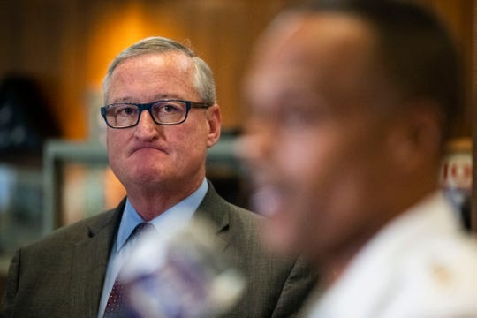Philadelphia Mayor Jim Kenney, listens to Police Commissioner Richard Ross speak during a news conference in Philadelphia, Thursday, July 18, 2019. The Philadelphia Police Department is suspending 13 police officers with an intent to fire them following an investigation into offensive and sometimes threatening Facebook posts.
