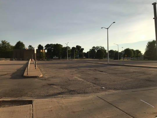 "The parking lot behind the former Daily Tribune building will be converted into a ""market square"" under a proposed city plan."