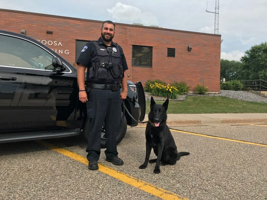 Nekoosa Officer Andrew Berg and his new K-9 partner, Ivo.