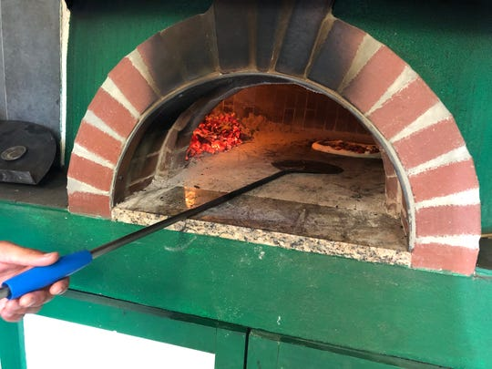 Hugh Farmer built this oven, which cooks pizzas at 900 degrees and uses mesquite as its wood.