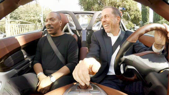 Host Jerry Seinfeld, right, drives passenger Eddie Murphy around Los Angeles during a Season 11 episode of Netflix's 'Comedians in Cars Getting Coffee.'