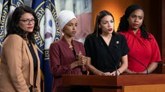 "From left, Rep. Rashida Tlaib, D-Mich., Rep. Ilhan Omar, D-Minn., Rep. Alexandria Ocasio-Cortez, D-N.Y., and Rep. Ayanna Pressley, D-Mass., respond to remarks by President Donald Trump after his call for the four Democratic congresswomen to go back to their ""broken"" countries, during a news conference at the Capitol in Washington, July 15, 2019. All are American citizens and three of the four were born in the U.S."