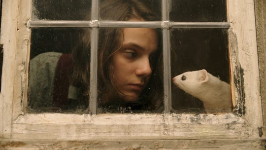 "Dafne Keen stars as Lyra in ""His Dark Materials."""