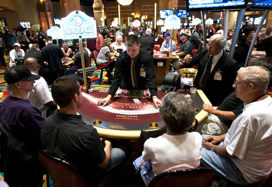 Patrons play blackjack during the first day of table games at Hollywood Casino at Penn National Race Course in East Hanover Township, Pa. Tuesday, July 13, 2010.