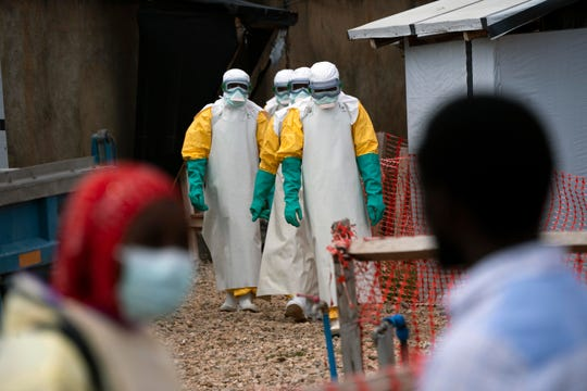 Health workers dressed in protective gear begin their shift at an Ebola treatment center in Beni, Democratic Republic of Congo.