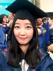 This 2016 selfie provided by her family shows Yingying Zhang in a cap and gown for her graduate degree in environmental engineering from Peking University Shenzhen Graduate School in China.