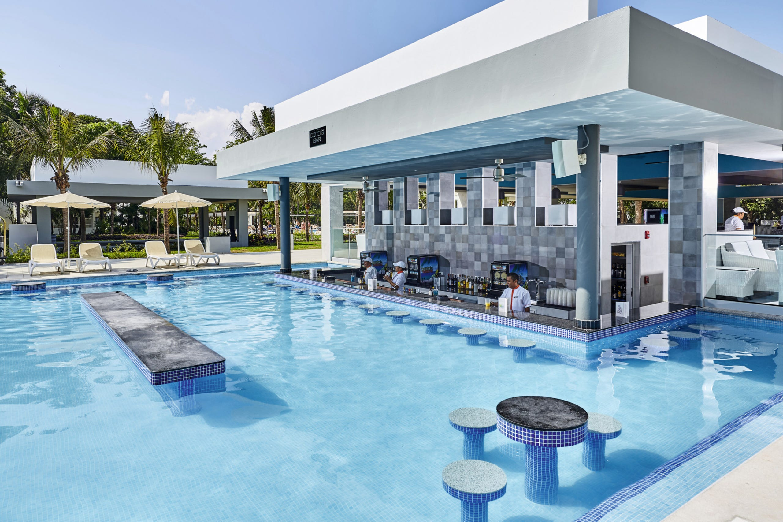 These luxury swim-up bars make a boozy and bougie summertime ...