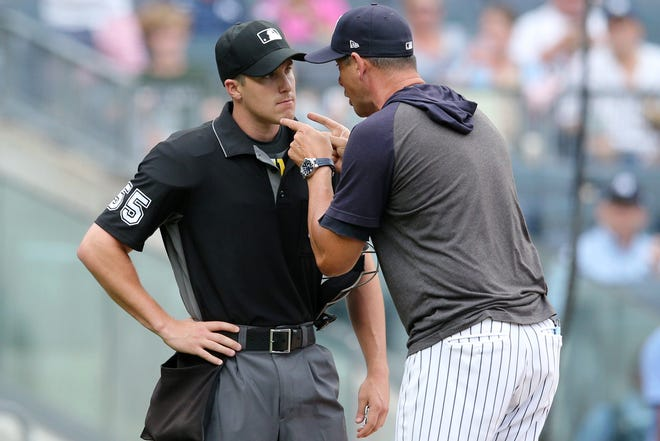 New York Yankees manager Aaron Boone (17) argues with home plate umpire Brennan Miller (55) after being ejected during the second inning of the first game of a doubleheader against the Tampa Bay Rays at Yankee Stadium.
