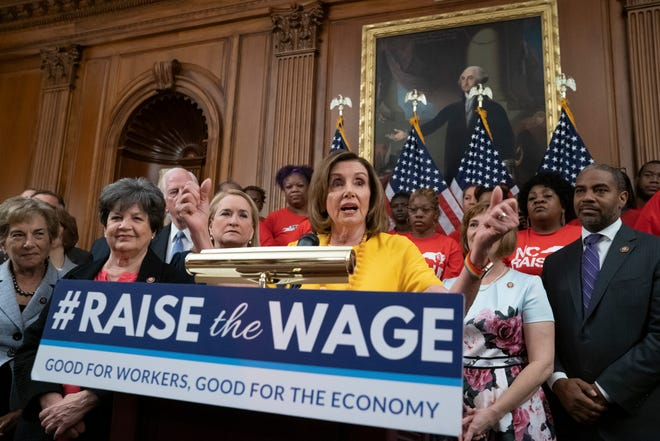 Speaker of the House Nancy Pelosi, D-Calif., joins fellow Democrats and activists seeking better pay as the House approved legislation to raise the federal minimum wage for the first time in a decade _ to $15 an hour, at the Capitol in Washington, Thursday, July 18, 2019. The bill is expected to fail in the Republican-controlled Senate.
