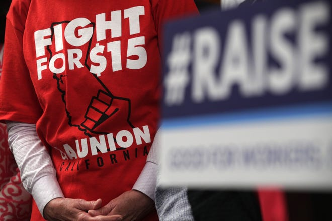 "An activist wears a ""Fight For $15"" T-shirt during a news conference prior to a vote on the Raise the Wage Act July 18, 2019 at the U.S. Capitol in Washington, DC. The legislation would raise the federal minimum wage from $7.25 to $15 by 2025."