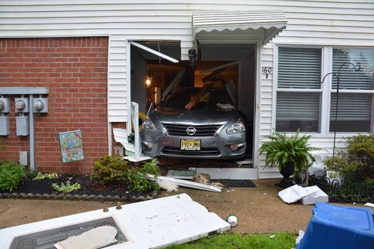 A 2014 Nissan Altima crashed through the front door of a home in Manchester July 18, 2019.