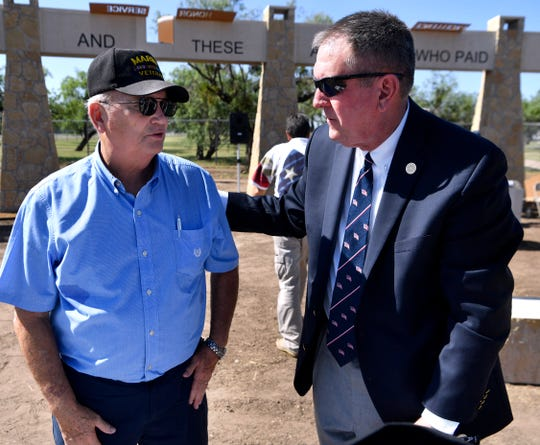 "Roy Barnette (left), the brother of Lt. Col. Benjamin Barnette Jr., who died in Turkey in 1980, speaks with State Rep. Stan Lambert during Friday's dedication of the Dyess Memorial Park expansion. Barnette, who lives in North Carolina, said his brother ""breathed"" the Air Force."