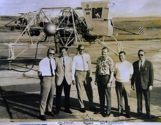A photo provided by Martha Anderson of her brother Charles Haines with Neil Armstrong and others in front of the Lunar Landing Vehicle in the late 1960s.