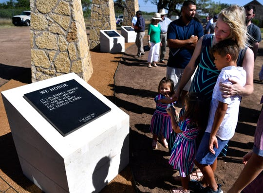Jessica Vallejo remembers her grandfather John Brace as she holds her daughters Victoria and Abigail, and son Kristopher, Friday. Vallejo came to the dedication of the Dyess Memorial Park expansion with her husband, Jose, her grandmother Martha, and other members of her family to honor her grandfather who died Oct. 12, 1966, near Guthrie with four other crewmen.