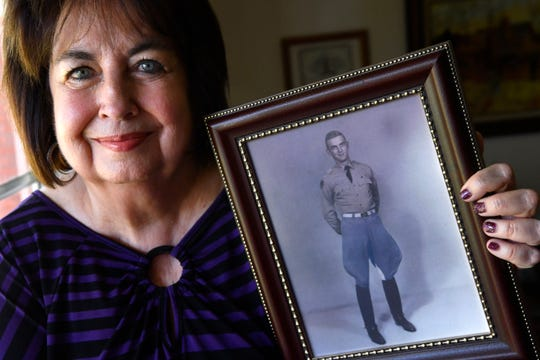 Martha Anderson with a portrait of her brother Charles Haines when he graduated from Texas A&M in 1957, at her home in Colorado City on Tuesday. Anderson graduated from Colorado High School in 1953 and went on to work on the Apollo space program in the 1960s.