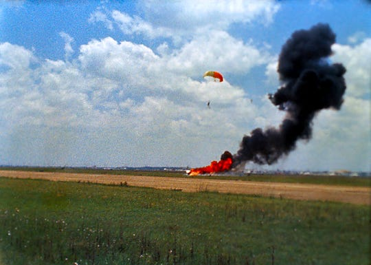 Neil Armstrong floats to earth after ejecting from his Lunar Landing Research Vehicle on May 6, 1968, in this still taken from NASA film. Armstrong was unharmed.