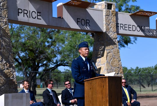 Col. Ed Sumangil, commander of the 7th Bomb Wing, delivers his remarks Friday at the dedication of the Dyess Memorial Park expansion.