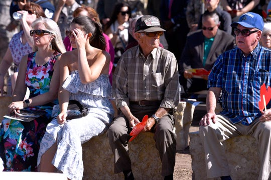 Veterans, family members and guests listen to remarks delivered by civilian and military officials during Friday's dedication of the Dyess Memorial Park expansion.